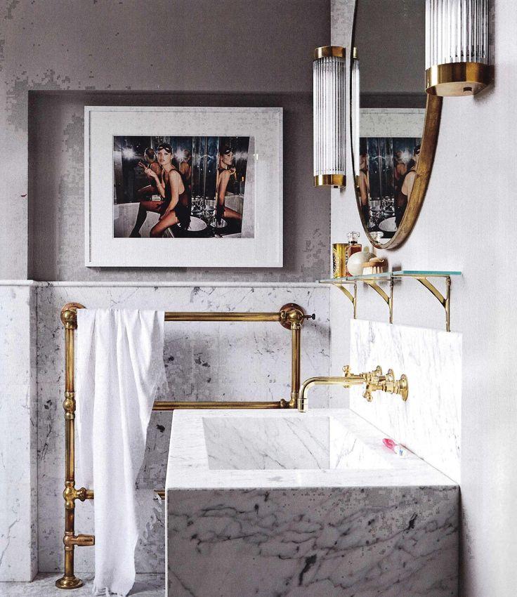 Marble bathroom, brass metalwork, Kate Moss artowrk, Living Etc.