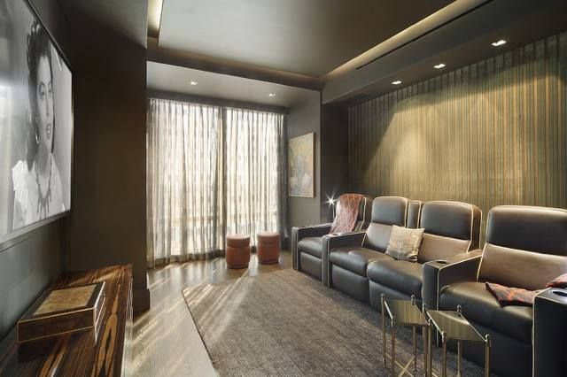 This New York City media room stays dark with Blackout Shades by NY City Blinds.