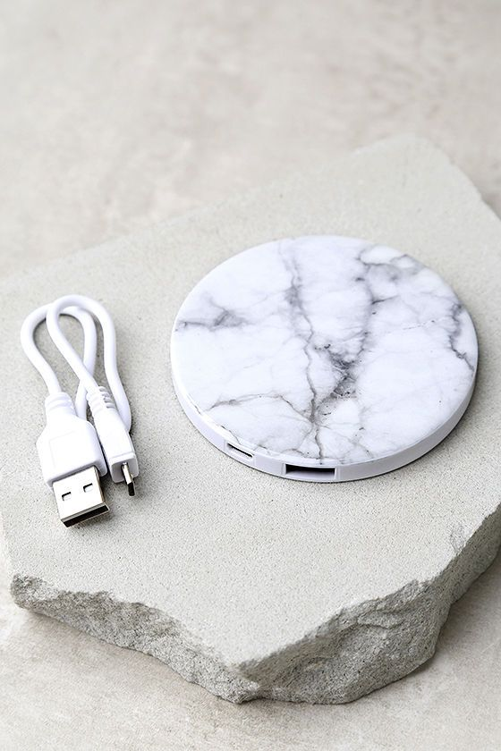 Not so large, but totally in charge! The In Charge White Marble Print Phone Power Bank puts power at your fingertips anytime and anywhere! A white marble design decorates this ultra thin, rechargeable external battery with a mirrored reverse that's perfect for quick makeup touch ups. Compatible with all smart phones, mobile devices, tablets, speakers, and more. USB charging cable included.