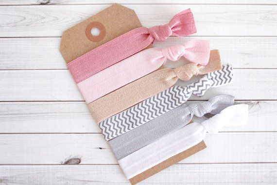 Set of 6 Creaseless Hair Ties  This elastic hair tie set includes the following colors and quantities:  1 Dusty Rose Solid Hair Tie 1 Pearl Pink