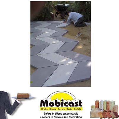Two tones of gray #chevron shaped pavers installed. Adds a modern touch to the backyard. Mobicast ( Bricks, Blocks, Pavers and Kerbs ) - your first choice supplier of #bricks, #paving, cladding and retaining blocks