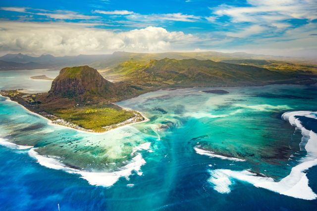 (GoodOlga via Getty Images) Where To Go On Holiday In 2018: Mauritius, Indian Ocean, in 2018,  marks 50 years since Mauritius proclaimed independence from the UK.  The island's celebrations are set to include ceremonies, live music and performances on the national day, 12th March. As part of wider celebrations throughout the year, you can explore all four corners of the island - from the bustling and vibrant city of Port Louis in the north to the Chamarel Seven Coloured Earths and…