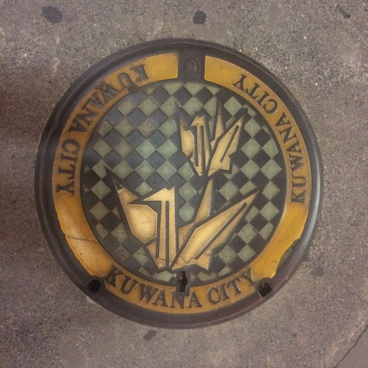 Origami crane manhole cover. Place: Kuwana city, Mie, Japan.