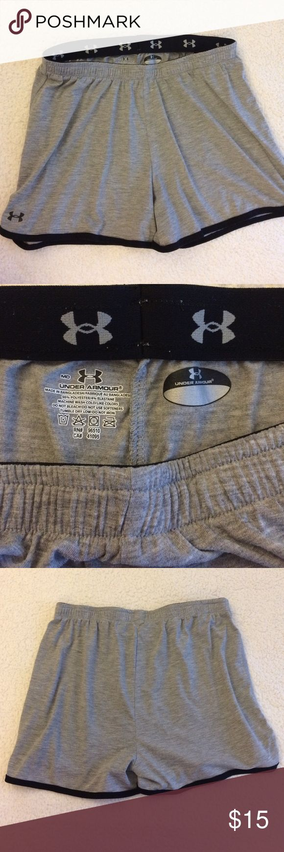 Under Armour Gray Shorts Classic heather gray running shorts. Soft polyester/elastane blend. Elastic waist is ~ 14 in. across front, and stretches far. Length is ~ 12.5 front, ~ 14 back. EUC, no significant signs of wear. **Bundle with black Under Armour shorts for discount! Under Armour Shorts