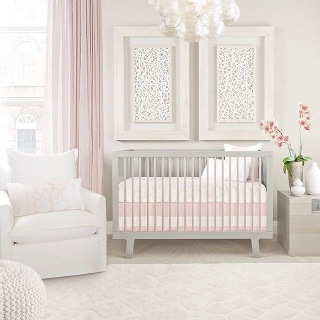Nursery goals, anyone?! This super-sweet pink and gray nursery hits it out of the park.