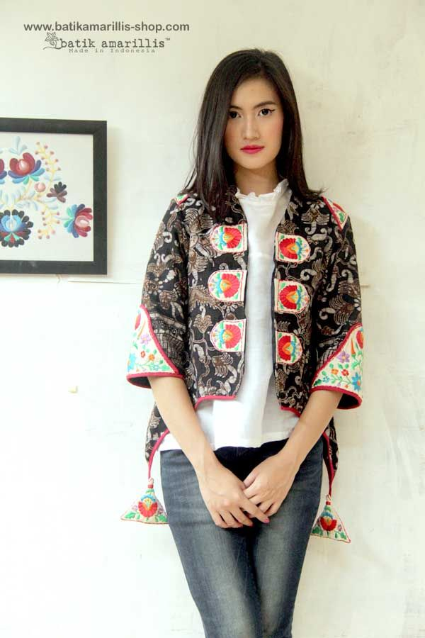 Batik Amarillis's Arcana jacket in Tenun batik gedog Tuban with hungarian embroidery ...Stand out in the crowd with this unique and stunning military cropped inspired jacket,this contemporary and yet vintage style is accented with exquisite embroidery on the shoulders epaulettes ,sleeves & chest adornments also features our triangle arcana tassels to complete the whole extravangant work of art!.