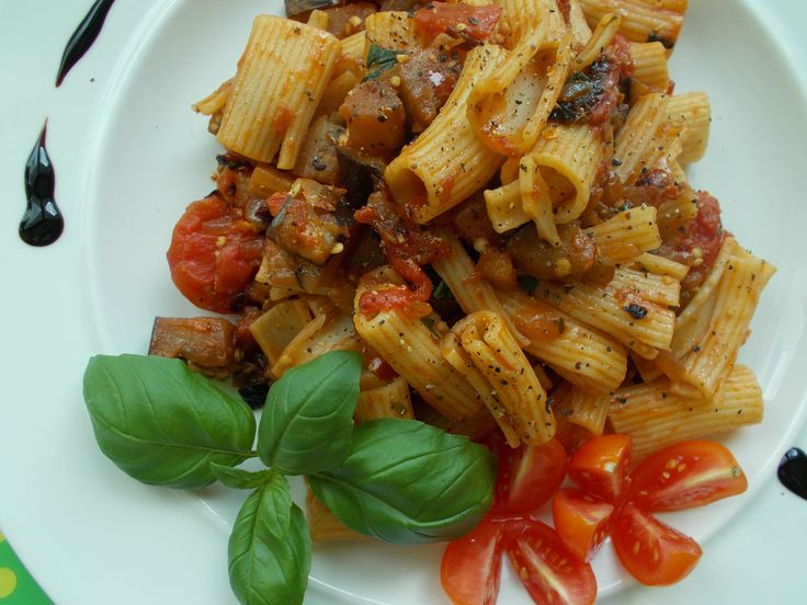 Pasta with sauce made of - yellow onion,garlic,dried chili,dried tomatoes,canned tomatoes,basil,eggplant and garnished with balsamico,basil and cherry.