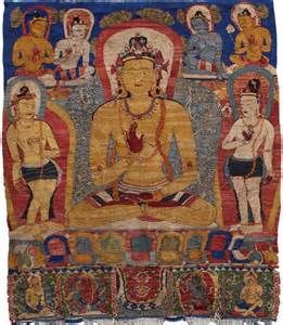 Amoghasiddhi, the Buddha of the North whose names means Unobstructed Success.. He holds his right hand in the mudra of fearlessness. His wisdom is 'All Accomplishing', reflecting his ability to act spontaneously to the needs of sentient beings. Appropriately he is head of the Karma family (karma meaning action).