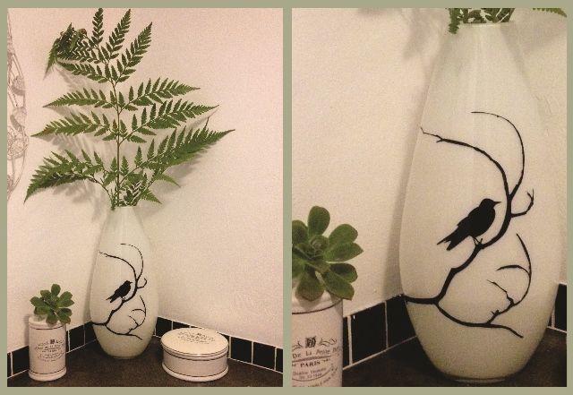 Bird sticker on a white vase