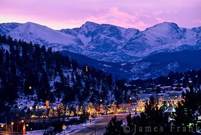Christmas lights brighten downtown Estes Park with Rocky Mountain National Park as a backdrop, Colorado. 2014