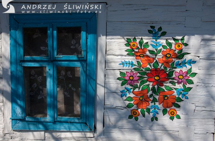 Floral pattern - decoration on wooden cottage. Poland.