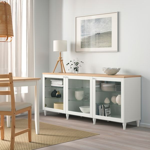 Besta Storage Combination With Doors White Ostvik Kabbarp White Clear Glass 180x42x76 Cm Ikea In 2020 Living Room Storage Ikea Glass Cabinet Doors