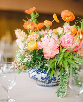 Pink And Orange Floral Centerpiece In Blue And White