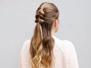 If you're tired of your basic, boring ponytail—but you don't have a lot of time to spend on your hair—this is the perfect updo.