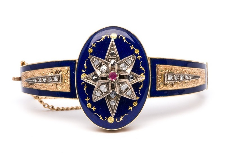 Victorian Enamel Star Bracelet - This stunning Victorian enamel bracelet dates to the 1880's. The royal blue enamel highlighted in this bangle bracelet enhance the warm tones of the gold. Accents of glittering single cut and rose cut diamonds add a glamorous sparkle to this truly fabulous antique bracelet.