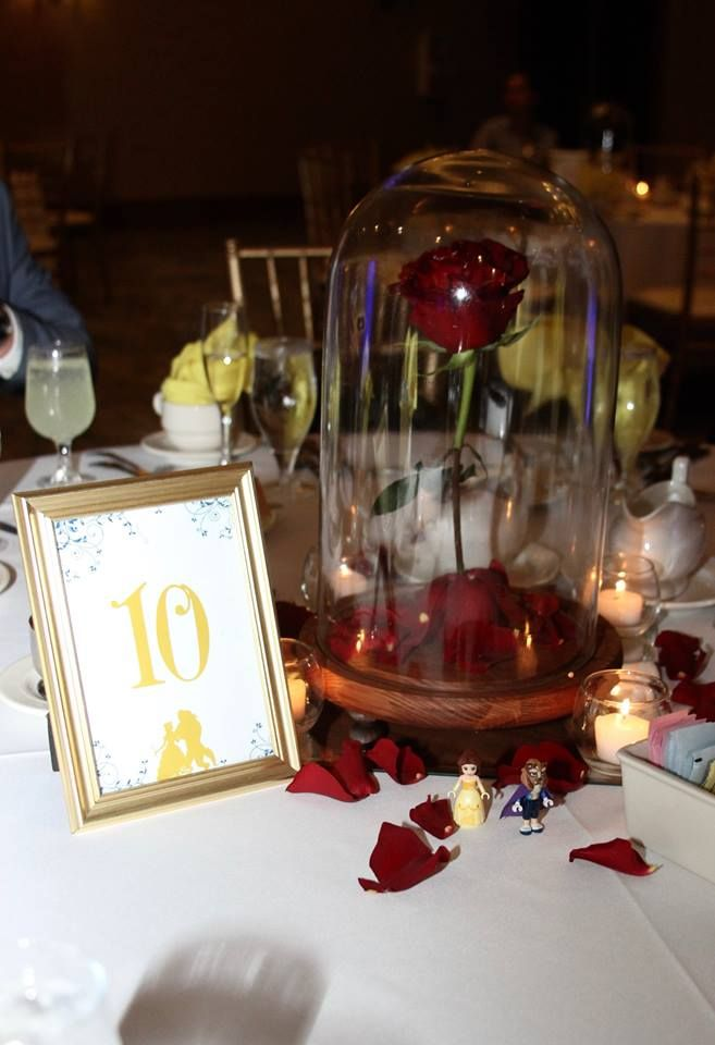 Beauty and the beast red rose centerpieces in a glass dome