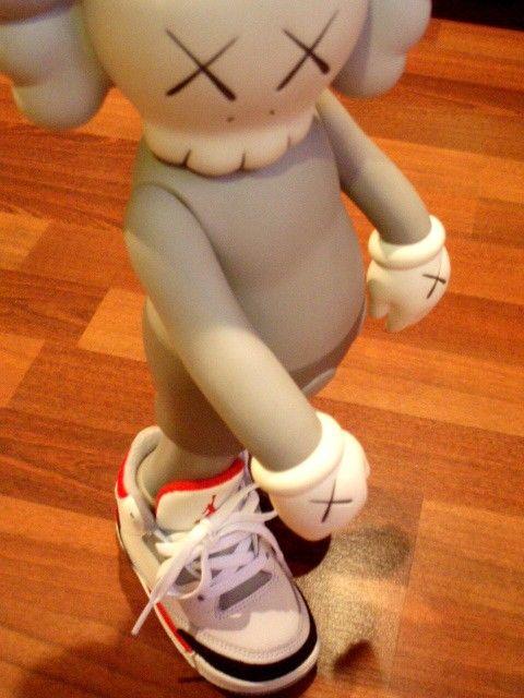 Kaws Figurine rockin' his Jordans
