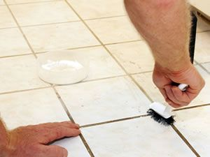 DIY Grout Cleaning Tips. Grout serves a noble purpose. Much like mortar, it creates a bond, fills voids, and seal joints. Bonding tiles together, grout makes floors and countertops stronger. Grout repels water and protects the edges of tiles from chipping. The color of your grout contributes to  the look of your tiled surfaces. But, grout is porous. It is susceptible to staining, can discolor, and attract mildew. When grout troubles begin, it's time to take action.
