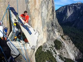 Image: Tommy Caldwell adjusts his tent while hanging off of Dawn Wall on the El Capitan mountain in California's Yosemite National Park.