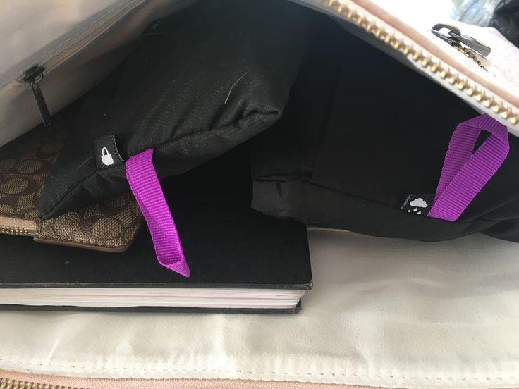Rain coat &a shopping bag in a handbag. We love our integrated pocket!