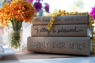 kraft paper covered books with wedding date, names and message - centerpiece idea
