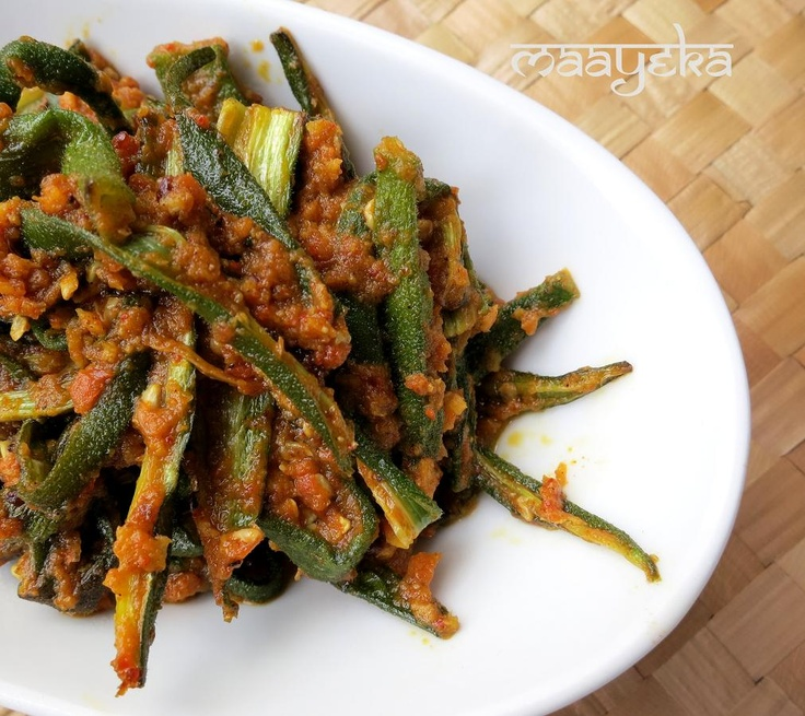 Hyderabadi Masala Bhindi  Crisp and spicy okra, stir fried with coconut and indian spices.