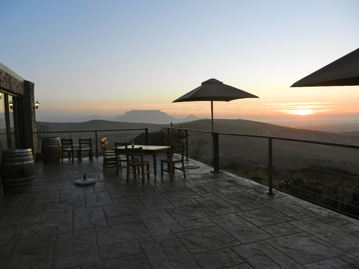Bloemendal Restaurant, Durbanville, Cape Town at sunset with Table Mountain in the distance.