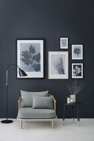 Grey scale scandi style living room detail with wall decor