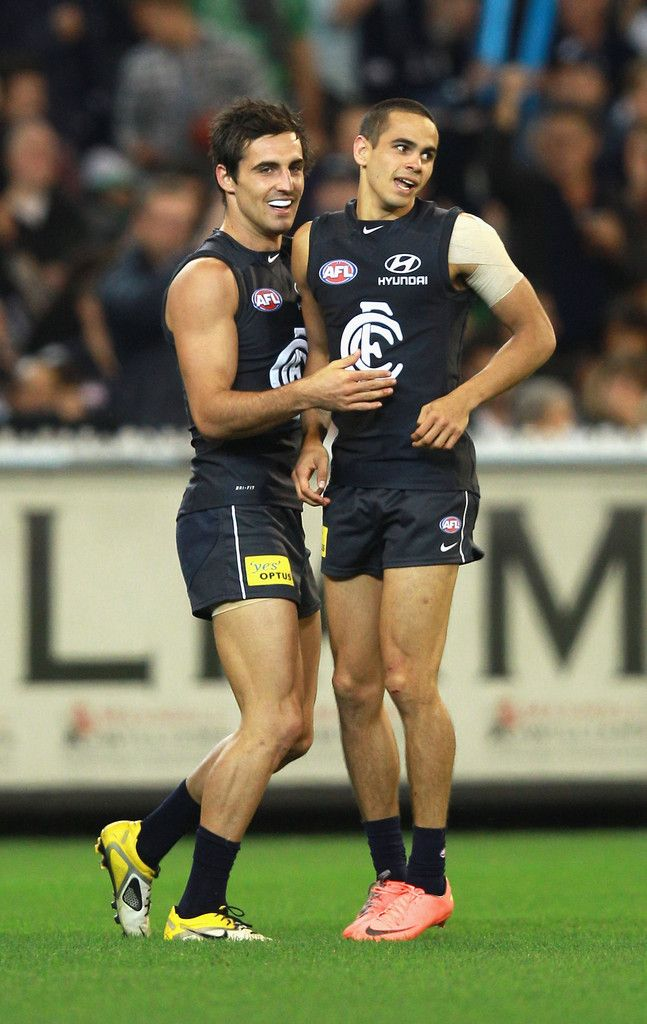 Jeff Garlett (R) of the Blues celebrates with team mate Kane Lucas after kicking a long running goal during the round three AFL match between the Carlton Blues and the Collingwood Magpies at Melbourne Cricket Ground on April 13, 2012 in Melbourne, Australia.