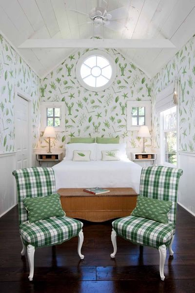 Here's a bedroom in a coastal cottage, but it doesn't have a beachy look- you can see how subtle the wallpaper is. Completely Coastal