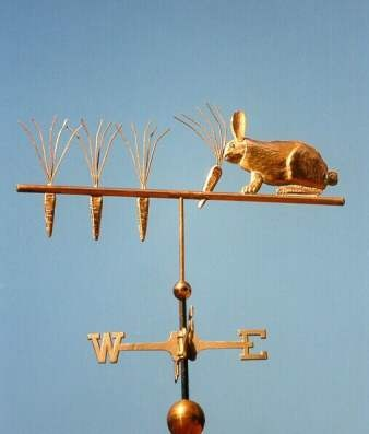 RABBIT WEATHER VANE Rabbit Weather Vane, Rabbit Pulling Carrots  by West Coast Weather Vanes.  The Rabbit Weather Vane above is handcrafted entirely from copper.  Parts of the weathervane may be made from brass or gold leafed to provide a contrast to the all copper rabbit weathervane. This Easter bunny busy all year long.