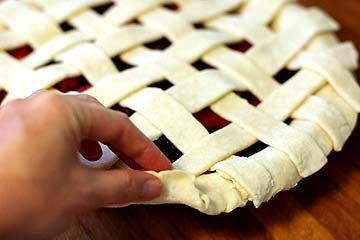 I used this site when I baked my last pie. It shows you step by step how to make a lattice top for a pie crust and I promise you, it's not nearly as difficult as it looks! :)