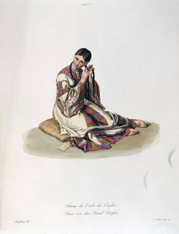 Otto Magnus von Stackelberg, Femme de l'isle de Cassos (Woman from Kassos [Dodecanese]), hand-coloured copper engraving, 36x24 cm. From his book Costumes et usages des peuples de la Grece moderne, Rome 1825  A similar dress from Kassos, an island near Karpathos in the Dodecanese, is depicted in the engraving.  ©Alpha Bank Photoographic Archive, Athens, Greece. All Rights reserved.