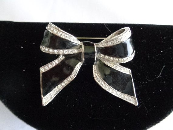 Black Rhinestone Bow Brooch on Sale. You can see more photos at www.CCCsVintageJewelry.com and the brooch is priced at $13.00. Look in the sale section in the store. There are many new items in the sale section - time to buy and get free shipping to the US via USPS First Class Mail. TX C