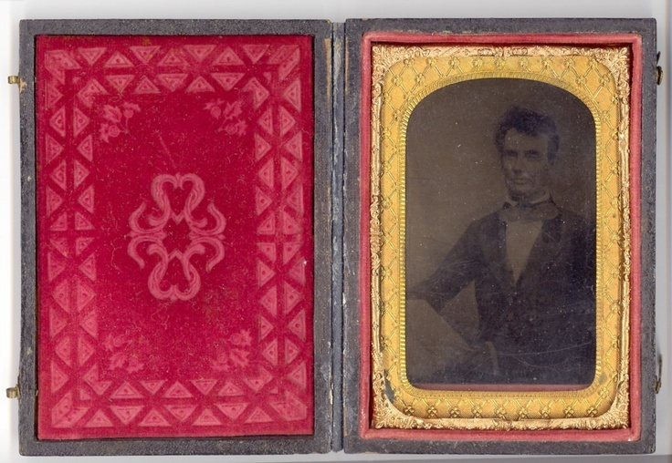 Rare Encased Tintype of Abraham Lincoln, holding issue of Progress Tribune newspaper, originally photographed in 1854 in Chicago,Illinois.  *s