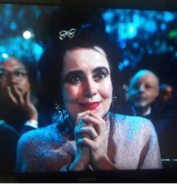 Mary Poole listening to Robert Smith's speech from the stage