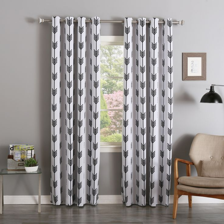 Give your home decor a dose of modern style and whimsy with this pair of arrow room darkening blackout grommet curtain panels. The curtains come with tiebacks, allowing you to easily pull back the curtains to let in light or loosen them for more privacy.