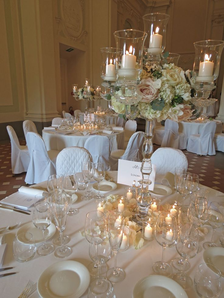 Cristal candelabra with white hydrangea, roses, bouvardia, eucharis, pale pink roses and greenery.
