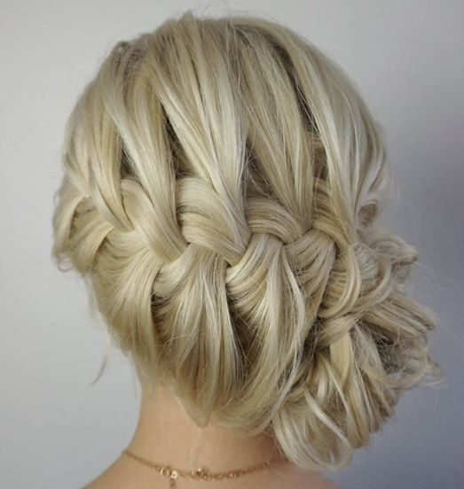 Chic braided low bun wedding hairstyle; Featured Hairstyle: Heidi Marie Garrett