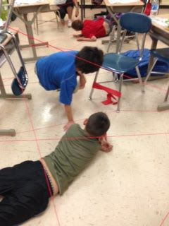 Mission Impossible: Use red string tied around chairs and desks to create a laser-beam obstacle course. Great for reward parties or a special indoor recess.