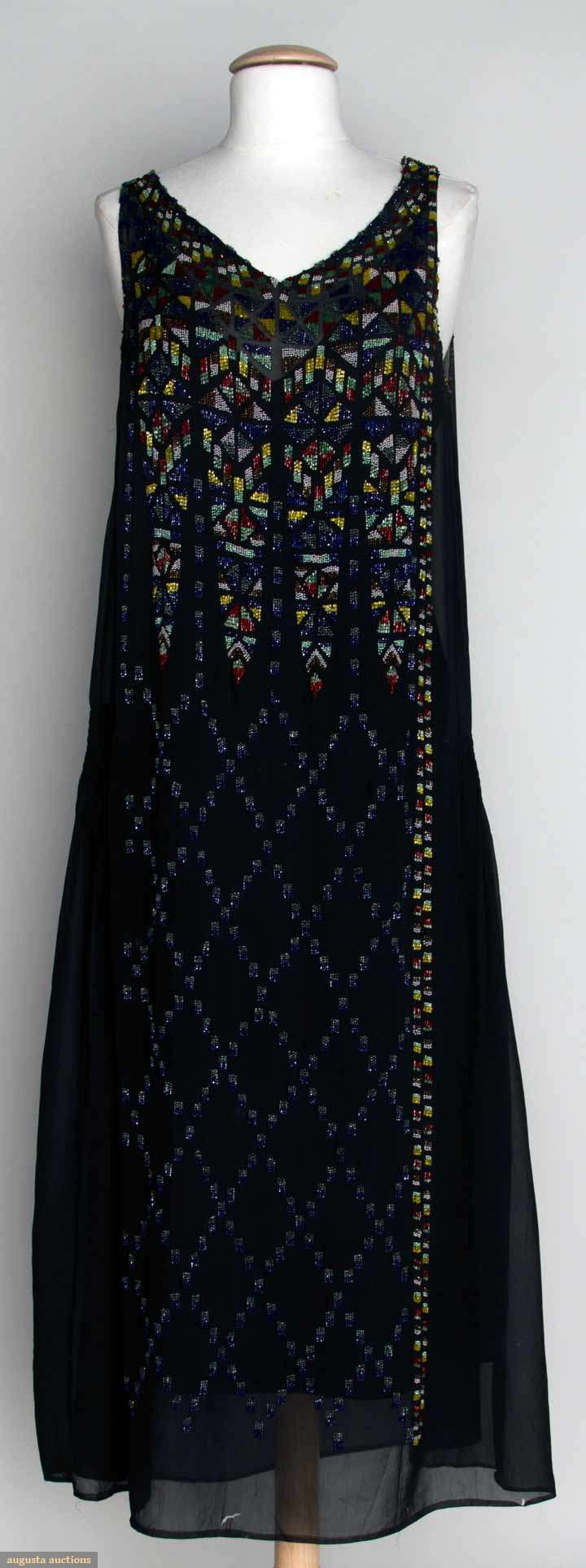 1920s black chiffon dress w/geometric beaded pattern predominantly in yellow, green, red, and blue.