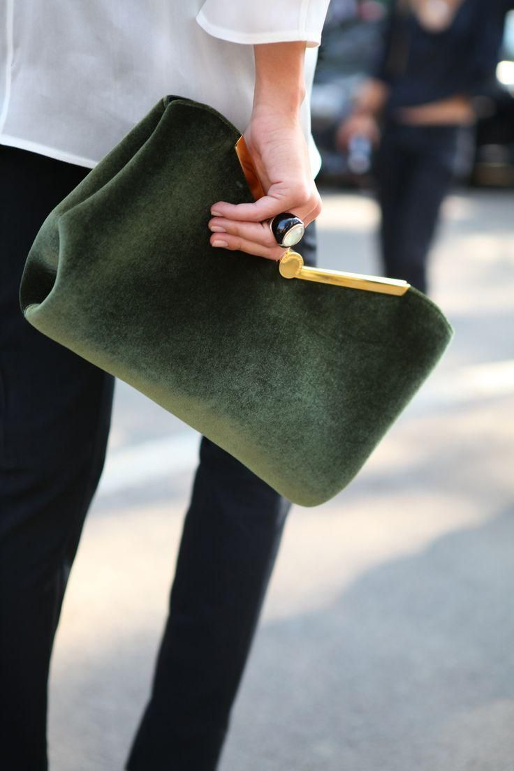 Green bag, black pants.