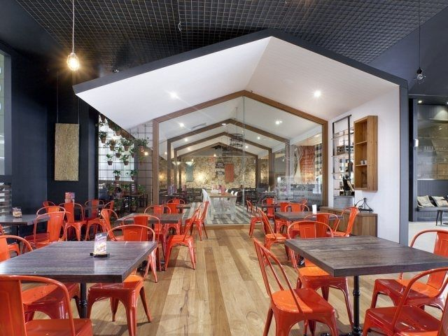 Yesterday we showed you an a-typical fast-food restaurant in Canberra, Australia; today we're taking a peek at another of the Nando's chain locations in Adelaide. The rustic farmyard influence is clear in the space, with a large barn-like installation framing the central interior. Inspired by Australia's agricultural and rural heritage, Design Clarity used vernacular architecture to resemble a simplified country shed. Complete with exposed trusses, a raised seating platform and even a coiled…