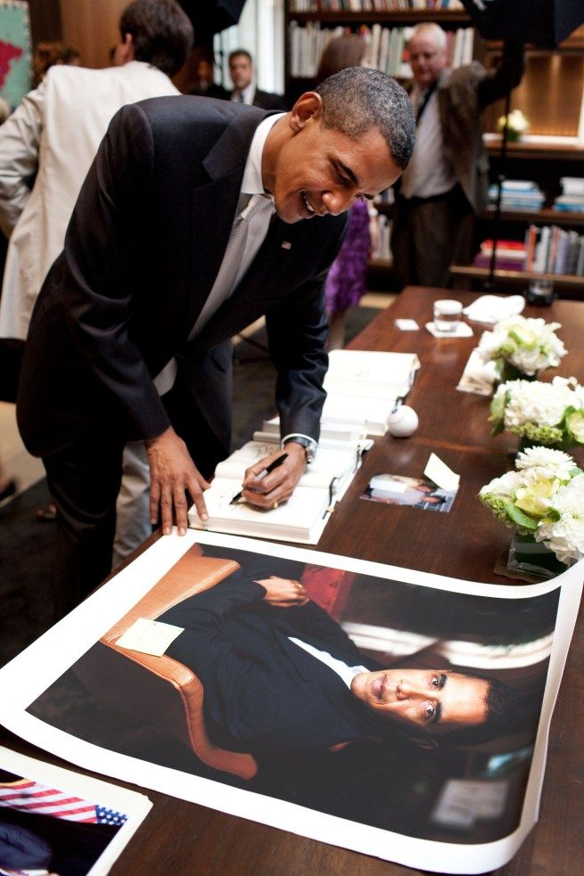 President Obama signs books and photos at a fundraiser in Chicago, Illinois on July 23, 2009