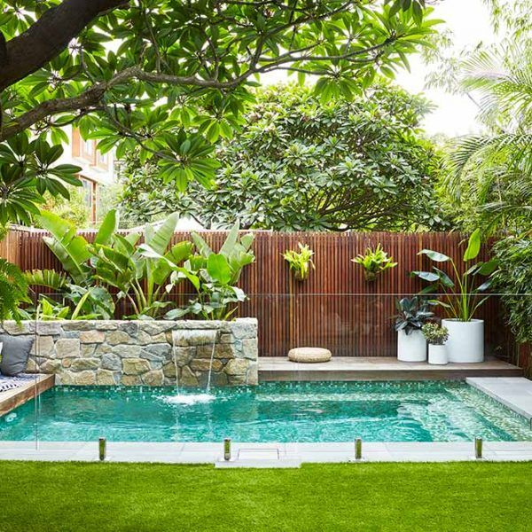 Small pool. Love the landscaping