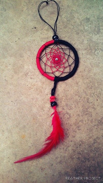 """2"""" Red and Black wrapping Red and Black webbing with a silver bead in the middle. Black and Red beads with a Red feather. Length: 7""""  https://www.facebook.com/featherprojectlk/"""