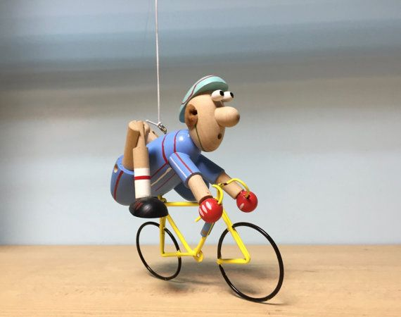Wooden hanging mobile cyclist available in blue and yellow