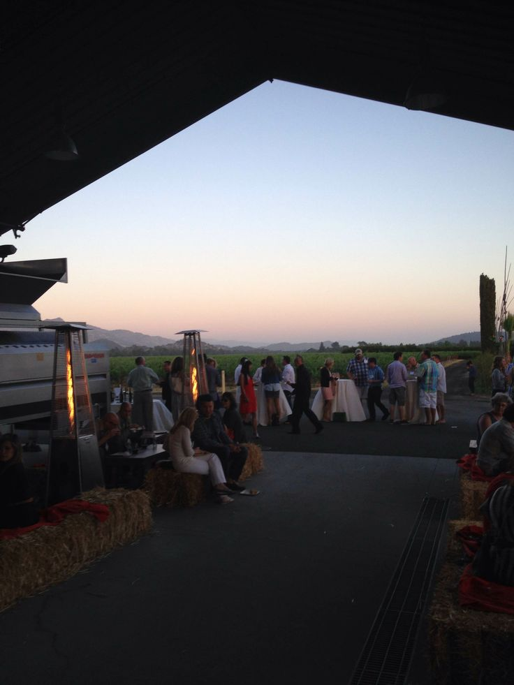 The sun finally sets over the vineyards at Round Pond Estate's Summer Solstice Party.