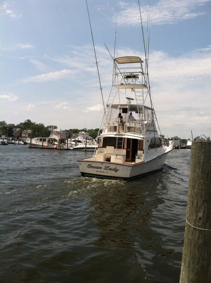 A sport fishing boat out of bay shore marina fun around for Nice fishing boats