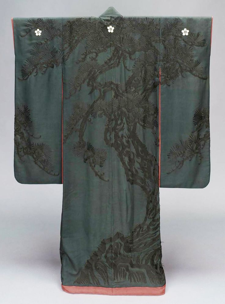 "Furisode, second half 19th century, Japan. ""Long-sleeved robe (furisode) with design of pine trees embroidered and couched in black silk on a black silk crepe ground, resist dyed; lined with red crêpe with design of bamboo embroidered in red silk; three white floral crests along the upper back and sleeves; padded hem. Silk plain-weave crepe ground embroidered and couched with silk; resist-dyed"""